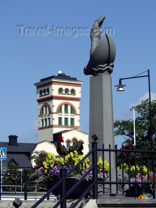 sweden97: Vastervik, Kalmar län, Sweden: Tourist Office and statue on boat - photo by A.Bartel - (c) Travel-Images.com - Stock Photography agency - Image Bank