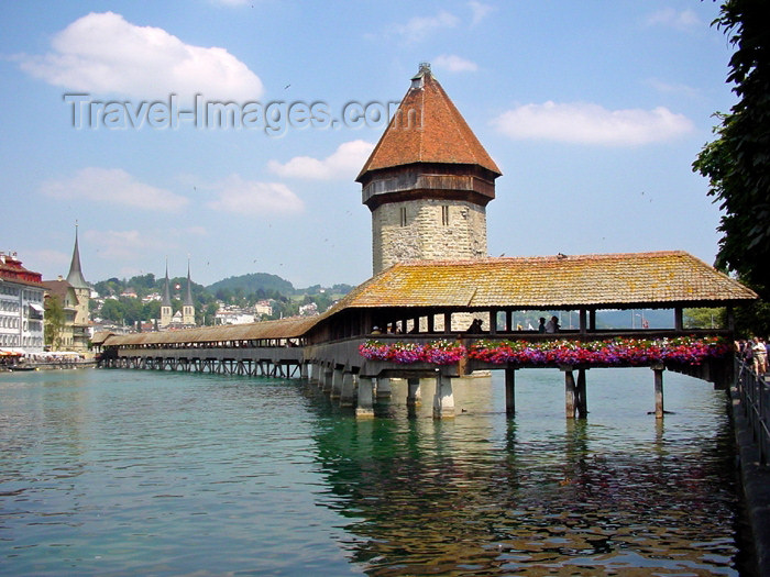 switz166: Switzerland / Suisse / Schweiz / Svizzera - Luzern / Lucerne / Lucerna: roofed wooden bridge - Kappelbrucke - Lake of the four Forest Cantons (photo by Christian Roux) - (c) Travel-Images.com - Stock Photography agency - Image Bank