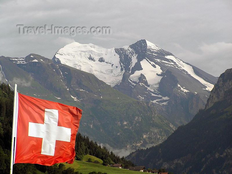 switz380: Switzerland - Bernese Alps - Swiss flag against the mountains - Drapeau de la Suisse et montagnes - Flagge der Schweiz - photo by J.Kaman - (c) Travel-Images.com - Stock Photography agency - Image Bank