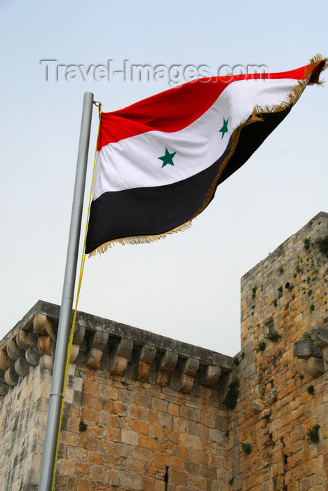 syria197: Crac des Chevaliers / Hisn al-Akrad, Al Hosn, Homs Governorate, Syria: Syrian flag at the castle's entrance - UNESCO World Heritage Site - photo by M.Torres /Travel-Images.com - (c) Travel-Images.com - Stock Photography agency - Image Bank