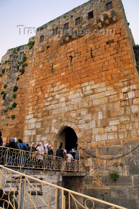 syria198: Crac des Chevaliers / Hisn al-Akrad, Al Hosn, Homs Governorate, Syria: students wait to enter the castle - UNESCO World Heritage Site - photo by M.Torres /Travel-Images.com - (c) Travel-Images.com - Stock Photography agency - Image Bank
