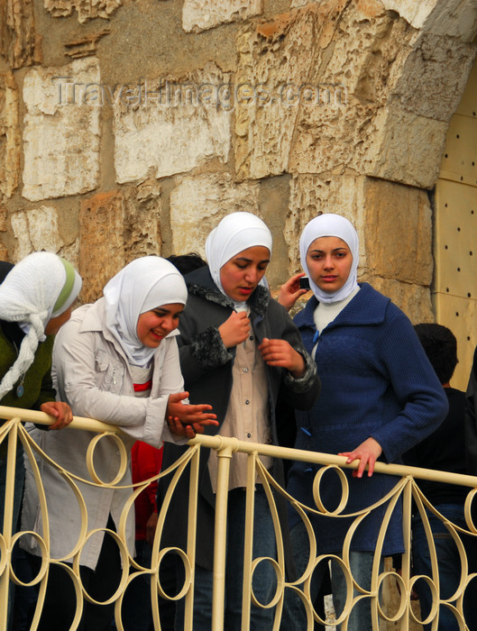 syria199: Crac des Chevaliers / Hisn al-Akrad, Al Hosn, Homs Governorate, Syria: SYrian girls with hijab at the castle gate - UNESCO World Heritage Site - photo by M.Torres /Travel-Images.com - (c) Travel-Images.com - Stock Photography agency - Image Bank
