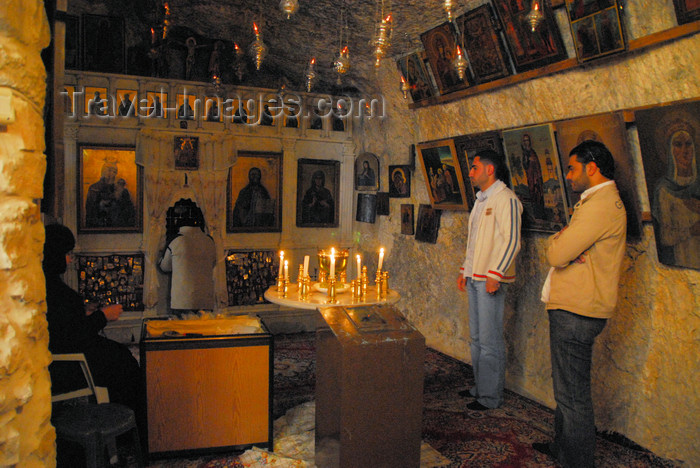 syria282: Maaloula - Rif Dimashq governorate, Syria:  Mar Taqla - praying at the Saint's chapel - shrine in a cave - photo by M.Torres / Travel-Images.com - (c) Travel-Images.com - Stock Photography agency - Image Bank