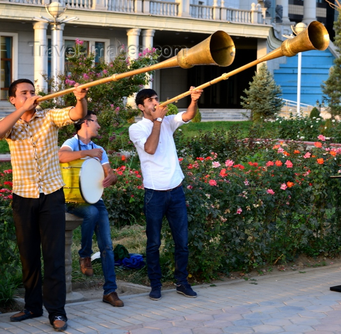 tajikistan42: Dushanbe, Tajikistan: muscians outside the National Library, Dusti square - karnay long trumpet, the national instrument - photo by M.Torres - (c) Travel-Images.com - Stock Photography agency - Image Bank