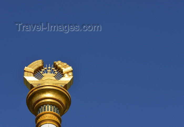 tajikistan9: Dushanbe, Tajikistan: column bearing the Tajikistani national emblem / coat of arms - Soviet style frame with crown, sun and the Pamir mountains - photo by M.Torres - (c) Travel-Images.com - Stock Photography agency - Image Bank