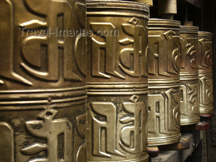 tibet18: Tibet - Lhasa: Jokhang Temple - prayer wheels - embossed hollow metal cylinders containing a scroll printed with a mantra - photo by M.Samper - (c) Travel-Images.com - Stock Photography agency - Image Bank