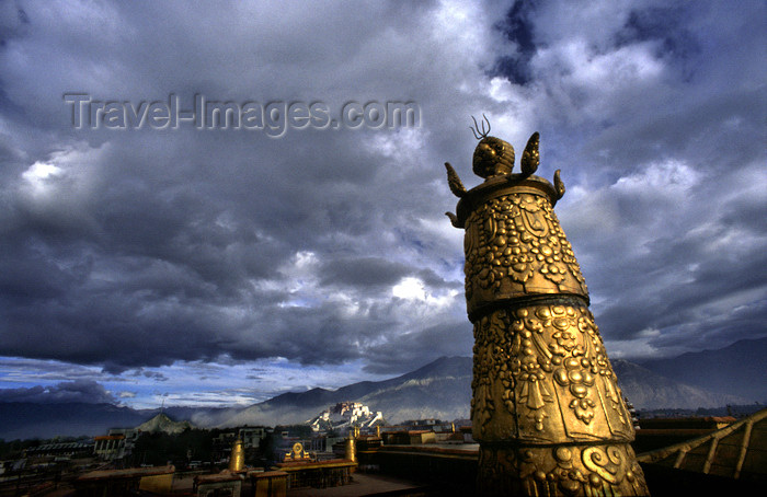 tibet74: Lhasa, Tibet: Jokhang Monastery - on the roof - gilded tower and Potala Palace - photo by Y.Xu - (c) Travel-Images.com - Stock Photography agency - Image Bank