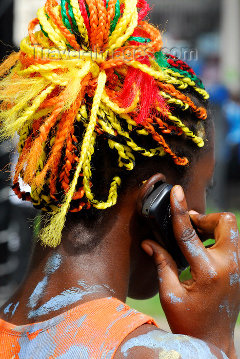 trinidad-tobago137: Port of Spain, Trinidad and Tobago: woman with colourful ropes on the hair - on the phone - carnival - photo by E.Petitalot - (c) Travel-Images.com - Stock Photography agency - Image Bank