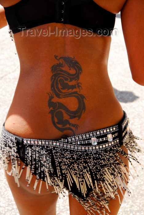 trinidad-tobago142: Port of Spain, Trinidad and Tobago: tattoo of a dragon on the back of a Trinidad girl - photo by E.Petitalot - (c) Travel-Images.com - Stock Photography agency - Image Bank