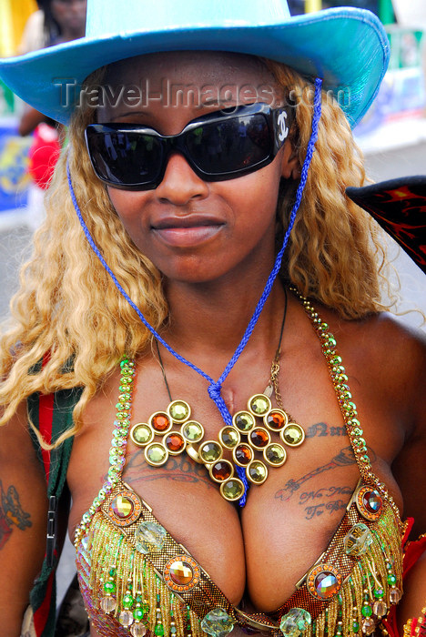 with tattoos on the breasts and wearing a blue hat - carnival - photo by