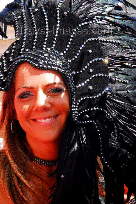 trinidad-tobago154: Port of Spain, Trinidad and Tobago: smiling white girl with black feathers on the head during carnival - photo by E.Petitalot - (c) Travel-Images.com - Stock Photography agency - Image Bank