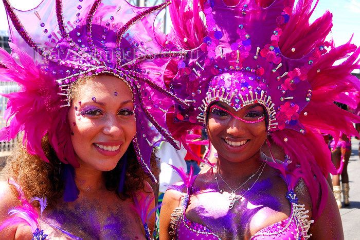 trinidad-tobago159: Port of Spain, Trinidad and Tobago: smiling girls with pink feathers - mulatto and white - carnival - photo by E.Petitalot - (c) Travel-Images.com - Stock Photography agency - Image Bank