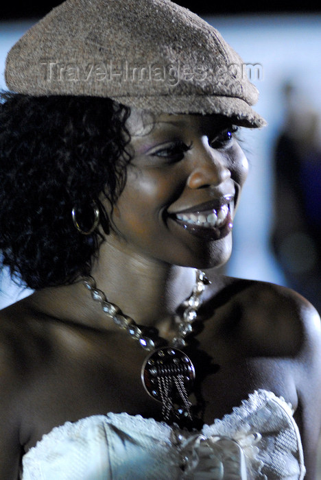 trinidad-tobago165: Port of Spain, Trinidad and Tobago: smiling black woman wearing a cap during carnival - photo by E.Petitalot - (c) Travel-Images.com - Stock Photography agency - Image Bank