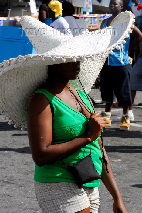 trinidad-tobago48: Port of Spain, Trinidad: woman wearing an immense sombrero hat for sun protection - photo by E.Petitalot - (c) Travel-Images.com - Stock Photography agency - Image Bank