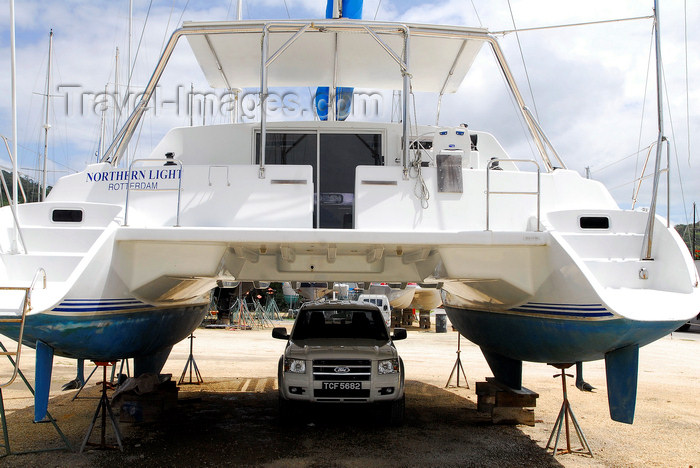 trinidad-tobago68: Port of Spain, Trinidad: catamaran undergoing repairs used like a garage at the harbour - Northern Light - photo by E.Petitalot - (c) Travel-Images.com - Stock Photography agency - Image Bank