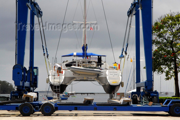 trinidad-tobago69: Port of Spain, Trinidad: taking a boat out of the water for repairs - mobile hoist and catamaran - boat handling Equipment - photo by E.Petitalot - (c) Travel-Images.com - Stock Photography agency - Image Bank