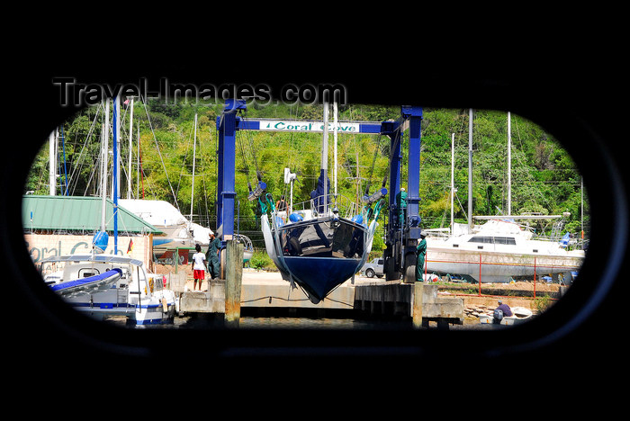 trinidad-tobago71: Port of Spain, Trinidad: taking a boat out of the water for repairs - mobile hoist - porthole view - photo by E.Petitalot - (c) Travel-Images.com - Stock Photography agency - Image Bank