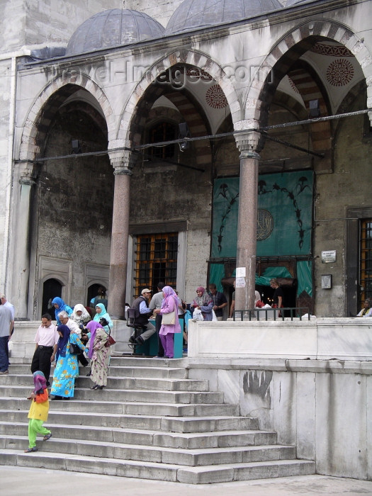 turkey137: Istanbul / Constantinople / IST, Turkey: the Blue Mosque - leaving - photo by R.Wallace - (c) Travel-Images.com - Stock Photography agency - Image Bank