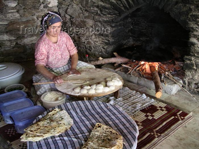 turkey152: Turkey - Selcuk / Seljuk Selcuk: gozleme maker: gozleme maker - photo by R.Wallace - (c) Travel-Images.com - Stock Photography agency - Image Bank