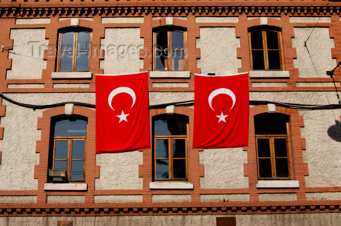 turkey175: Istanbul, Turkey: turkish flags - Istiklal caddesi, the Independence Avenue - Beyoglu district - photo by J.Wreford - (c) Travel-Images.com - Stock Photography agency - Image Bank