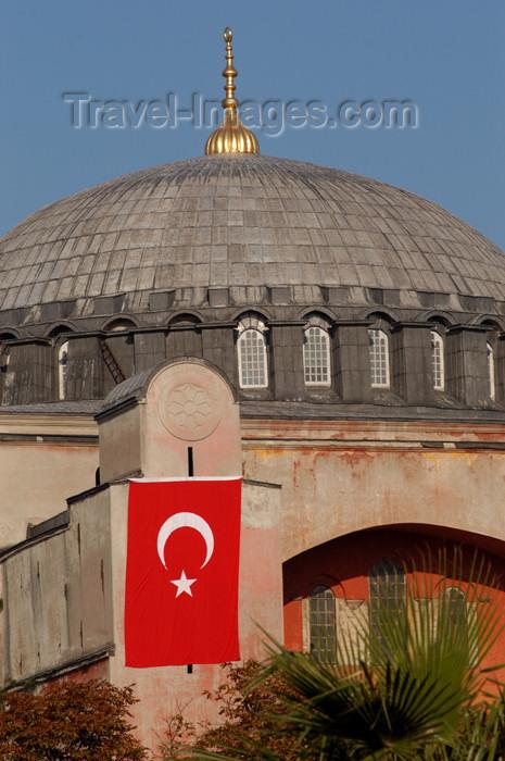 turkey205: Istanbul, Turkey: dome and flag - Aya Sofya - Sancta Sophia - Hagia Sophia - photo by J.Wreford - (c) Travel-Images.com - Stock Photography agency - Image Bank