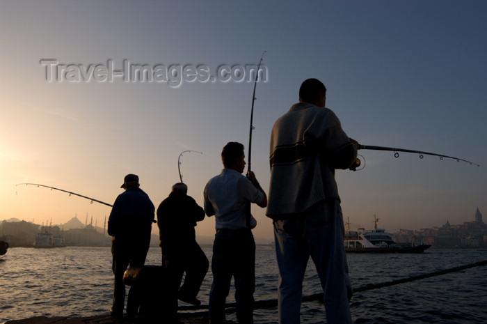 turkey217: Istanbul, Turkey: fishermen the Bosphorus - photo by J.Wreford - (c) Travel-Images.com - Stock Photography agency - Image Bank