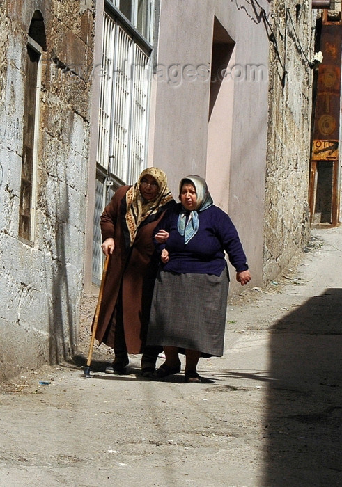 turkey260: Gaziantep, South-Eastern Anatolia, Turkey: old women help each other - photo by C. le Mire - (c) Travel-Images.com - Stock Photography agency - Image Bank