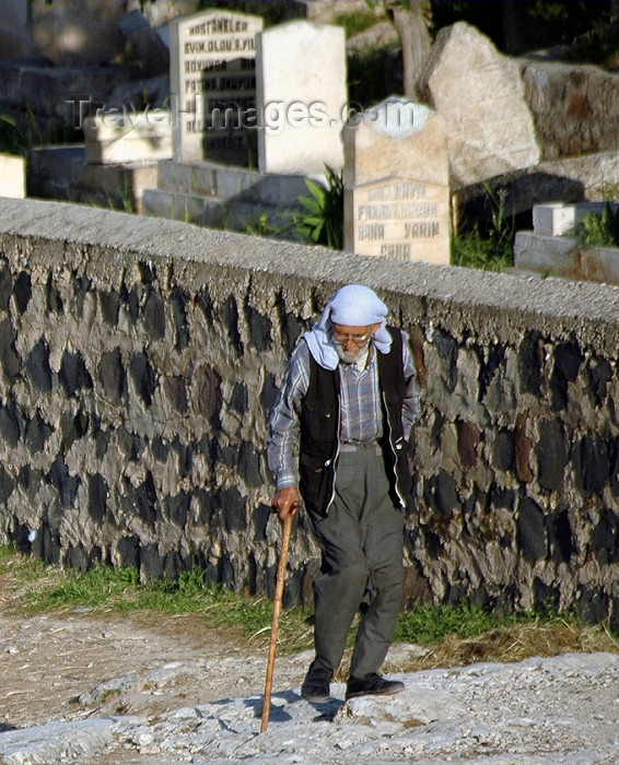 turkey315: Turkey - Urfa / Edessa: old man walking by the cemetery - photo by C. le Mire - (c) Travel-Images.com - Stock Photography agency - Image Bank