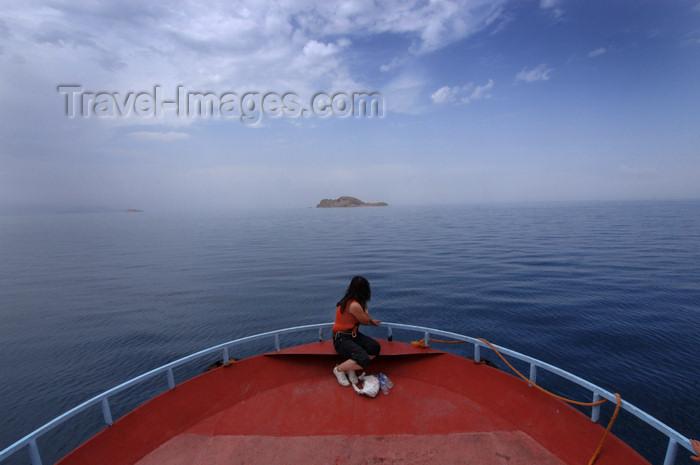 turkey549:  Lake Van / Gola Wanê / Van Gölü, Van province, Eastern Anatolia, Turkey: girl in a boat's prow - photo by J.Wreford - (c) Travel-Images.com - Stock Photography agency - Image Bank