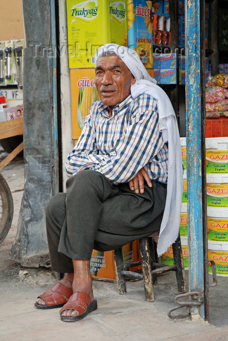 turkey557: Urfa / Edessa / Sanliurfa, Southeastern Anatolia, Kurdistan, Turkey: Kurdish man in his store - photo by W.Allgöwer - (c) Travel-Images.com - Stock Photography agency - Image Bank