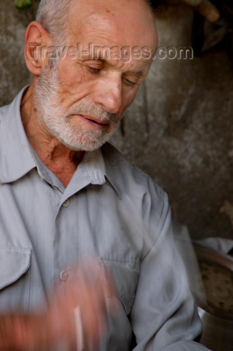 turkey580: Mardin - Southeastern Anatolia, Turkey: artisan working the metal - photo by J.Wreford - (c) Travel-Images.com - Stock Photography agency - Image Bank
