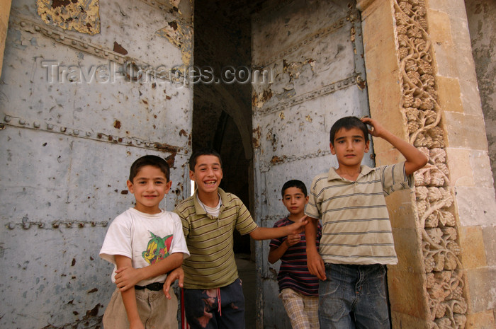 turkey582: Mardin - Southeastern Anatolia, Turkey: children and large gate - photo by J.Wreford - (c) Travel-Images.com - Stock Photography agency - Image Bank