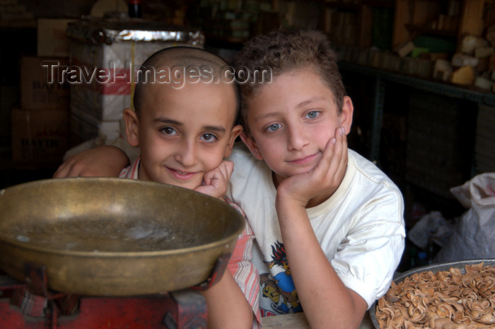 turkey583: Mardin - Southeastern Anatolia, Turkey: buddies - kids in a store - day dreamer deep in his thoughts - photo by J.Wreford - (c) Travel-Images.com - Stock Photography agency - Image Bank