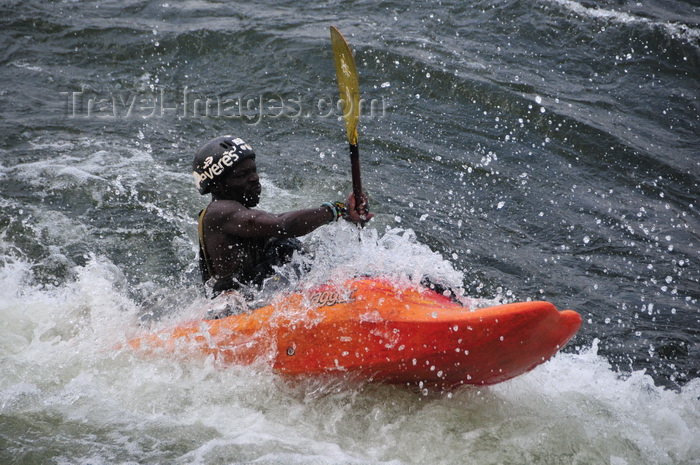 uganda154: Bujagali Falls, Jinja district, Uganda: kayaker struggles with turbolent water on the falls, a combination of catarats and rapids on the river Nile - seen from the Eastern bank - in 2012 the falls were submerged by the Bujagali Dam - photo by M.Torres - (c) Travel-Images.com - Stock Photography agency - Image Bank