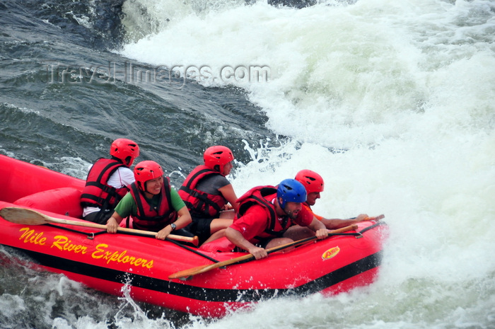 uganda155: Bujagali Falls, Jinja district, Uganda: white water rafters on an inflatable boat - catarats on the river Nile - seen from the Eastern bank - in 2012 the falls were submerged by the Bujagali Dam - photo by M.Torres - (c) Travel-Images.com - Stock Photography agency - Image Bank