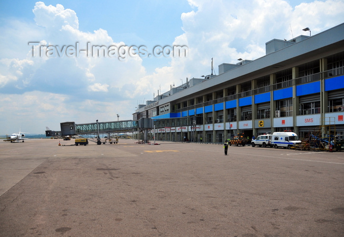 uganda16: Entebbe, Wakiso District, Uganda: Entebbe International Airport - terminal building with empty air-bridge and executive jet on the apron - photo by M.Torres - (c) Travel-Images.com - Stock Photography agency - Image Bank