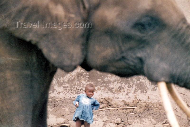 uganda2: Africa - Uganda - Queen Elizabeth National park - QENP: elephant and young girl (photo by Nacho Cabana) - (c) Travel-Images.com - Stock Photography agency - Image Bank