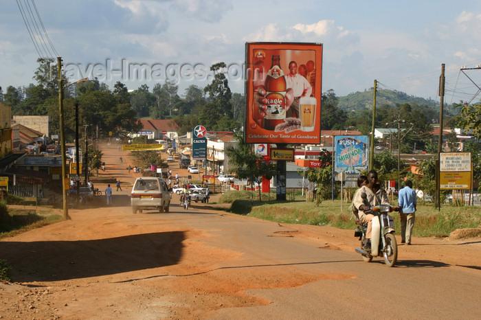 uganda55: Uganda - road scenery - beer billboard - photo by E.Andersen - (c) Travel-Images.com - Stock Photography agency - Image Bank