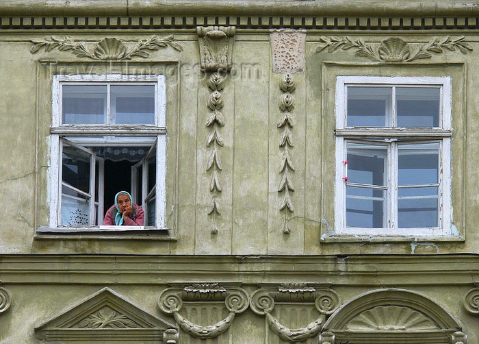ukra87: Lviv / Lvov, Ukraine: old lady looking out from window - photo by J.Kaman - (c) Travel-Images.com - Stock Photography agency - Image Bank