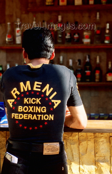 ukra97: Odessa, Ukraine: young man standing at bar counter, rear view - jeans and t-shirt reading 'Armenia Kick Boxing Federation' - photo by K.Gapys - (c) Travel-Images.com - Stock Photography agency - Image Bank