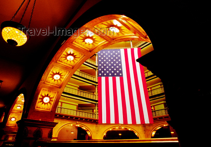 usa102: Denver, Colorado, USA: a large American flag hangs inside the Brown Palace Hotel - photo by C.Lovell - (c) Travel-Images.com - Stock Photography agency - Image Bank