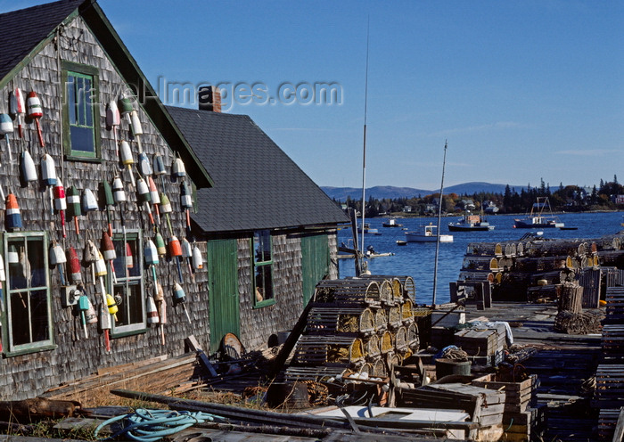 usa1094: Maine, USA: lobster traps and floats on fishing wharf – wooden house with shingles - photo by C.Lovell - (c) Travel-Images.com - Stock Photography agency - Image Bank