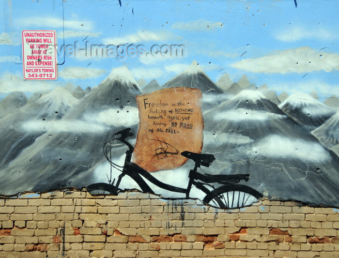 usa1724: Boise, Idaho, USA: bike and mountains - 'freedom is the feeling of nothing beneath you, yet having no fear of the fall' - graffiti on Freak Alley - photo by M.Torres - (c) Travel-Images.com - Stock Photography agency - Image Bank