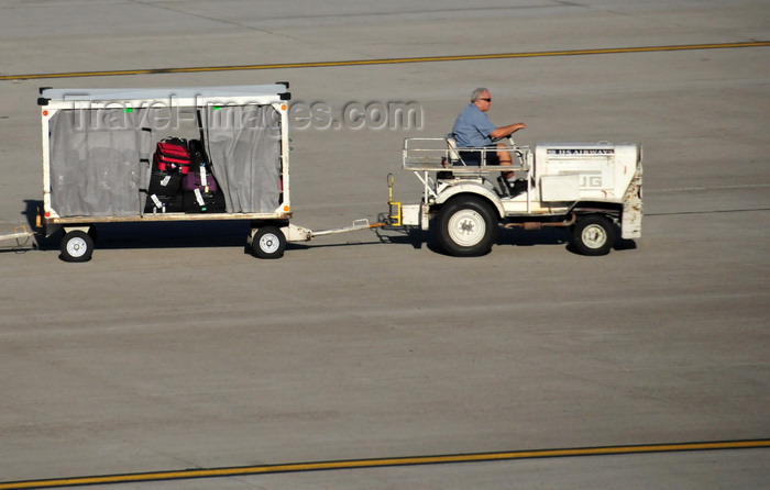 Airport Baggage Tugs http://www.travel-images.com/photo/photo-usa184.html