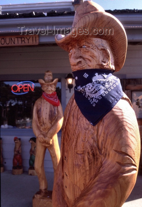 usa267: Newport (Oregon): wooden cowboys - photo by F.Rigaud - (c) Travel-Images.com - Stock Photography agency - Image Bank