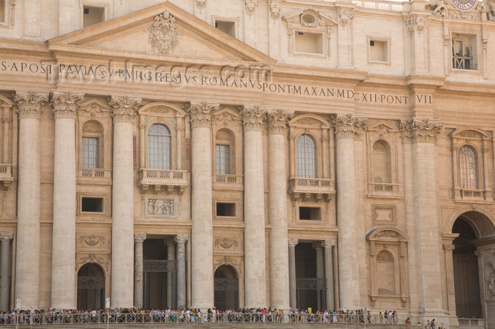 vatican49: Vatican City, Rome - Saint Peter's Basilica - façade in travertine stone by Carlo Maderno - inscription 'IN HONOREM PRINCIPIS APOST PAVLVS V BVRGHESIVS ROMANVS PONT MAX AN MDCXII PONT VII' - photo by I.Middleton - (c) Travel-Images.com - Stock Photography agency - Image Bank
