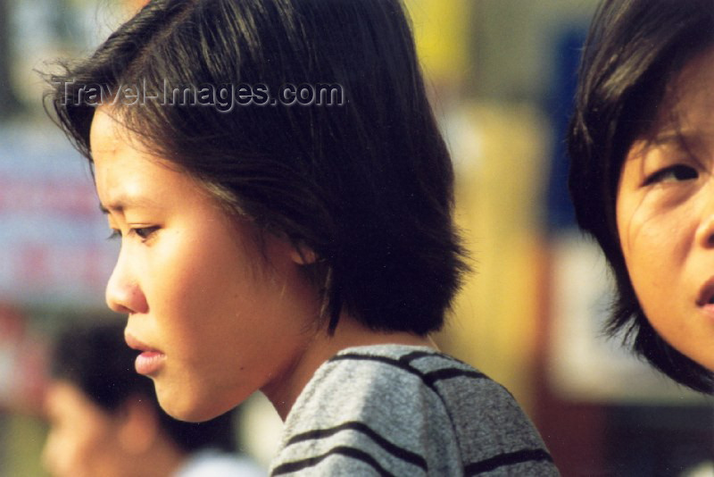 vietnam33: Hanoi - Vietnam: faces in the crowd - photo by Nacho Cabana - (c) Travel-Images.com - Stock Photography agency - Image Bank