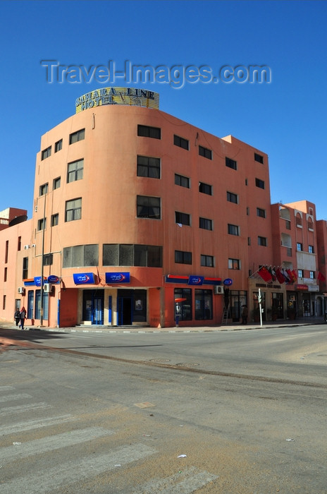 western-sahara24: Laâyoune / El Aaiun, Saguia el-Hamra, Western Sahara: Sahara Line and Maroc Telecom shop - intersection of Blvds el-Kairaouane and 24 Novembre 1975 - photo by M.Torres - (c) Travel-Images.com - Stock Photography agency - Image Bank