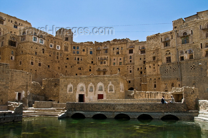 yemen103: Hababah, Sana'a governorate, Yemen: the town's old cistern is still used - pool and neighbouring stone houses - photo by J.Pemberton - (c) Travel-Images.com - Stock Photography agency - Image Bank
