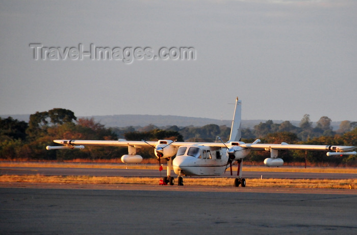 zambia51: Lusaka, Zambia: Britten-Norman BN-2T Turbine Islander, used by Airborne Petroleum Geophysics for geophysics surveys, carries a airborne gravimeter - Lusaka / Kenneth Kaunda International Airport - LUN - photo by M.Torres - (c) Travel-Images.com - Stock Photography agency - Image Bank